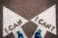 I can and can t dilemma concept with man legs from above standing on signs Stock Images
