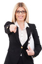 I choose you cheerful mature businesswoman pointing and smiling while standing isolated on white Royalty Free Stock Photos