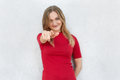 I choose you! Cropped shot of woman in red dress pointing at camera with index finger isolated over white background. Pretty woman