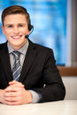I am happy to help you smiling customer support executive over white Stock Photography
