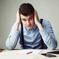 I hate my office work. Young businessman working in office. Low Royalty Free Stock Photo