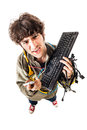 I hate this service a casual guy with tangled cables and a keyboard struggeling to get computer assistance isolated on white Royalty Free Stock Photo