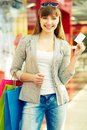 I have discount pretty lady with colorful shopping bags showing credit card Stock Photos