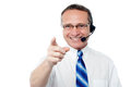 I am here to help you cheerful customer support executive against white background Royalty Free Stock Image
