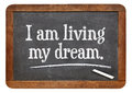 I am living my dream positive affirmation words on a vintage slate blackboard Stock Photography