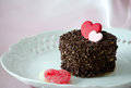 I love cake a small delicious round coated with chocolate chips and decorated with a pink and red heart made from chocolate Royalty Free Stock Photo