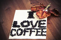 I love coffee note on wooden table with orange leaf Royalty Free Stock Photography
