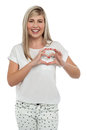 I am in love. Girl making heart with fingers. Royalty Free Stock Photos