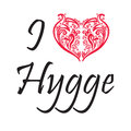I love Hygge text in black symbolizing Danish Life style with floral swirly heart shape in red on white background Royalty Free Stock Photo