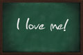 I love me written on green chalkboard Stock Photo