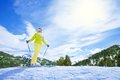 I love mountain ski happy young woman skier stand on top of the slope piste Stock Images