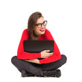 I love my new laptop smiling beautiful girl in black glasses sitting on the floor with legs crossed and cuddle full length studio Royalty Free Stock Photography