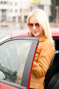 I love my new red car beautiful blond woman with sunglasses and her Royalty Free Stock Image