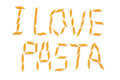I love pasta words written with penne pieces isolated on white background Royalty Free Stock Photography