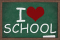 I love school heart written on a chalkboard with a piece of chalk Royalty Free Stock Photo