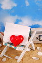 I love summer holidays red heart and blank board on deckchair on the beach as concept Stock Photo