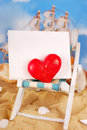 I love summer holidays red heart and blank board on deckchair on the beach as concept Royalty Free Stock Photography