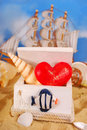 I love summer holidays red heart and shell in wooden box on the beach as concept Stock Photo