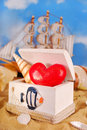I love summer holidays red heart and shell in wooden box on the beach as concept Royalty Free Stock Photos