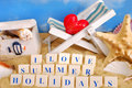 I love summer holidays text arranged with letter blocks on the beach Royalty Free Stock Photo