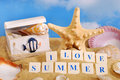 I love summer text arranged with letter blocks on the beach Royalty Free Stock Image