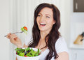 I love to eat healthy salad Stock Photography