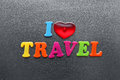 I love travel spelled out using colored fridge magnets on metal surface Stock Image