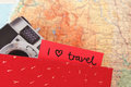 I love travelling written note on map Royalty Free Stock Photo