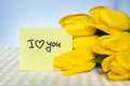 I love you, card with words and yellow tulips flowers Royalty Free Stock Photo