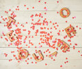 I love you composition te quiero meaning in spanish written with the block letters covered with red heart shaped confetti over the Stock Image