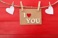 I Love You message card over red wooden board Royalty Free Stock Photo