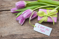 I love you mom fresh tulips and tag on wooden background Stock Photography