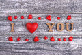 I love you, wooden lettering, gray background, postcard Happy Valentine day, flat lay Royalty Free Stock Photo