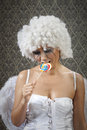 I m happy don t worry girl in white angel costume with lollipop left all alone and crying Stock Images