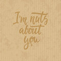 I`m nuts about you - hand drawn lettering phrase  on the cardboard grunge background. Fun brush ink inscription Royalty Free Stock Photo
