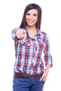 I made my choice attractive young smiling woman looking at camera and pointing you while standing isolated on white Royalty Free Stock Image
