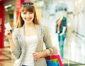 I pay by card pretty lady with shopping bags showing credit Royalty Free Stock Photography