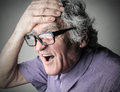 I regret portrait of elderly man with expression of Royalty Free Stock Photo