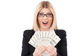 I am rich happy mature businesswoman holding money in her hands and smiling while standing isolated on white Stock Images