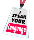 I speak your language name badge translator words on a or tag to offer translation services to foster greater communication and Royalty Free Stock Photography
