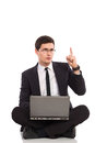I ve got an idea young man in black suit holds laptop on his crossed legs and pointing up full length studio shot isolated on Stock Photo