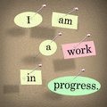 I am a work in progress quote saying bulletin board or on pieces of paper pinned to to illustrate accepting your flaws or Royalty Free Stock Photos