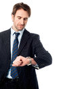 I would reach on time young professional looking at his watch Stock Photos