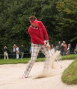 Ian Poulter plays bunkershot. Royalty Free Stock Images