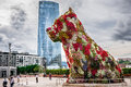 Iberdrola tower and puppy sculpture bilbao spain october on october in bilbao spain the was designed by architect caesar Royalty Free Stock Images