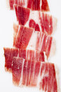Iberian ham background of on a white background Stock Photography