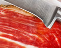 Iberian ham slice of jamon with knife closeup Royalty Free Stock Image