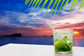 Ibiza cala Conta Conmte sunset with Mojito drink Stock Photos
