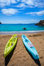 Ibiza cala sant vicent beach with kayaks san juan at balearic islands of spain Royalty Free Stock Photography