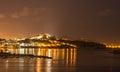 Ibiza island night view of Eivissa town and sea lights reflectio Royalty Free Stock Photo
